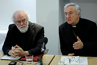Britain's Archbishop of Canterbury Rowan Williams, left, from the Anglican church listens as Archbishop of Westminster Vincent Nichols from the Roman Catholic Church speaks during a news conference in London, held in reaction to the announcement of a new church structure for Anglicans who want to join the Catholic Church. (Christian Science Monitor photo)