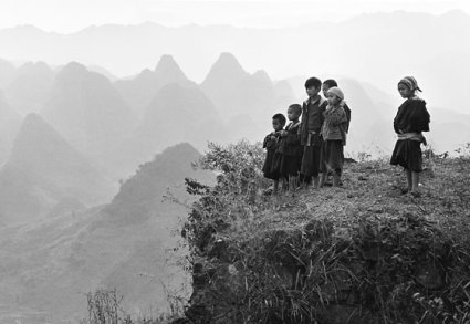 "Where a road is built through a mountainous region, young children have run uphill to watch automobiles. An Ge, 1983. (From ""Humanism in China: A Contemporary Record of Photography,"" at New York City's China Institute through Dec. 13)"