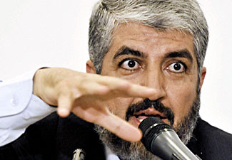 Exiled Hamas leader Khaled Meshaal talks about Fatah-Hamas reconciliation during a press conference in Cairo on Monday. (Zhang Ning/Newscom photo.)