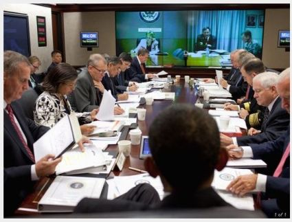 President Obama (back to camera) holds a briefing on Afghanistan and Pakistan with his national security team in the Situation Room of the White House on Wednesday. (Getty Images)